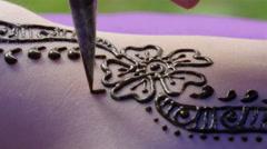 Flower design henna tattoo on a girls arm Stock Footage