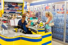 Customers paying for shopping at a supermarket - stock photo