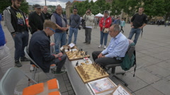 Two men playing chess in a square, Stuttgart Stock Footage