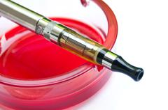 E-cigarette on red ashtray Stock Photos