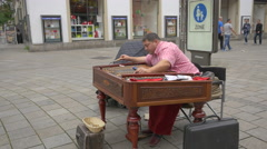 Musician playing the cimbalom on Konigstrasse, Stuttgart Stock Footage