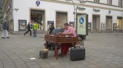 Playing the cimbalom in the city center of Stuttgart Stock Footage