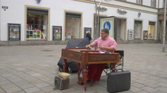 Man playing the cimbalom in the city center of Stuttgart Stock Footage