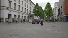 Street performer adjusting the cimbalom in Stuttgart Stock Footage