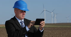 Wind Turbines Maintenance Engineer Check Energy Production Use Tablet Software Stock Footage
