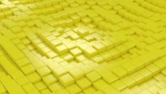 Yellow cubic surface in motion. - stock footage