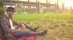Young hipster relaxing at Park Stock Footage