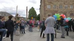 Playing snare drums and tambourine and waving rainbow flag, Stuttgart Stock Footage