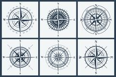 Set of isolated compass roses or windroses . Vector illustration. Stock Illustration