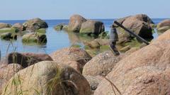 Concept of shipwreck: sea has cast ashore broken yacht Navigator - stock footage