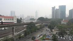 Road and LRT tracks at Kuala Lumpur during severe haze Stock Footage