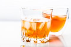 Two different glasses of whiskey - stock photo
