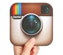 KIEV, UKRAINE - APRIL 29, 2015:Hand holds Instagram logotype printed on paper Stock Photos
