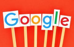 KIEV, UKRAINE - SEPTEMBER 02, 2015:New Google logotype printed on paper, cut - stock photo
