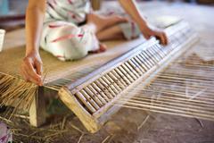 Vietnamese woman weaving a mat - stock photo