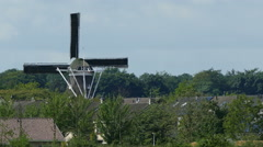 Dutch windmill in small city Stock Footage