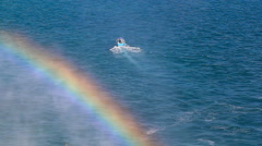 Stock Video Footage of Small Boat and Rainbow at Sea