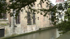 Canal by large brick building Stock Footage