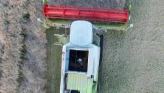 Combine harvester harvesting rapeseed (Aerial View) Stock Footage