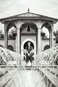Teenage boy standing at a fountain Stock Photos