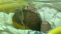 Hospital. Newborn baby in the hospital nursery in crib. Maternity ward Stock Footage
