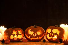 Three carved halloween pumpkin lanterns - stock photo