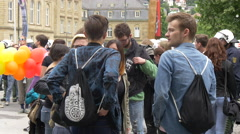 Young people gathered in Palace Square at Gay Pride, Stuttgart Stock Footage
