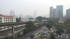 Road and LRT tracks at Kuala Lumpur during severe haze Stock Footage