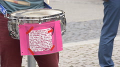 Snare drum with a message on a pink paper at Guy Pride, Stuttgart Stock Footage