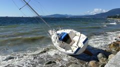 Sailboat Washes Up Against Rocks And Breakwall In Vancouver Stock Footage