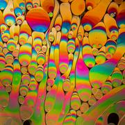 Psychedelic abstract formed by light reflecting off soap bubble - stock photo