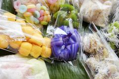 Thai dessert - many kind of Thai dessert in plastic bag at market Stock Photos
