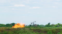 Flare Stack Burning In Oil Well While Producing Oil Gas - stock footage