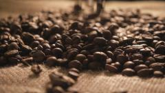 Coffee beans faking onto sacking in slow motion Stock Footage