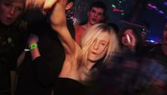 A crowd of people dancing on the drum and bass event Stock Footage