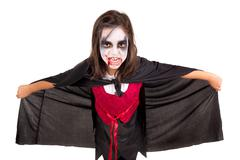 Girl in Halloween vampire costume Stock Photos