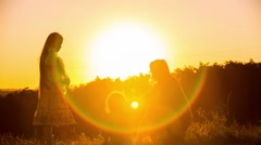 Happy Mother Dancing With Children At Sunset - stock footage