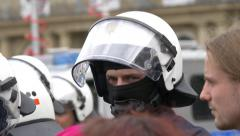 German police officer with white helmet and mask watching over, Stuttgart Stock Footage