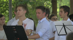 WGetting ready to play the trumpets in the park, Cluj-Napoca - stock footage