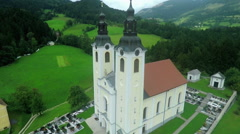 Church with two tops and a cemetery Stock Footage