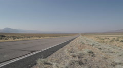 Truck Drives Along A Road in the Desert Stock Footage