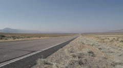 Vehicles Drive Along A Road in the Desert Stock Footage