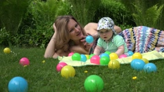mother and baby freetime in park with colourful ball. 4K - stock footage