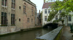 Canal in Bruges with a tunnel under a building Stock Footage