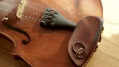 Old violin lying on the table near the window. - stock footage