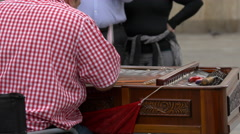 Musician playing the cimbalom on a street in Stuttgart Stock Footage