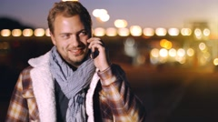 Handsome young man speaking on smart phone at atumn sunset Stock Footage