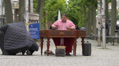 Street performer playing the cimbalom on Konigstrasse, Stuttgart Stock Footage