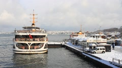 Ferryboat and Ferry Port in a snowy winter day Stock Footage