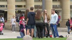Group of friends standing next to Konigsbau Passagen, in Schlossplatz, Stuttgart Stock Footage